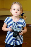 Little girl. Young photographer, holding a retro rangefinder camera Royalty Free Stock Photography