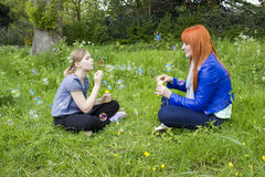 Little girl and young woman blowing soap bubbles Royalty Free Stock Photography