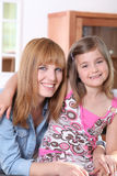 Little girl and young woman smiling Royalty Free Stock Photography