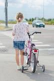 Little girl on zebra crossing. Royalty Free Stock Image