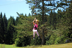 Little girl on a zip line Stock Photography