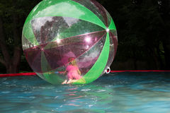 Little girl in Zorb in the pool Stock Photo