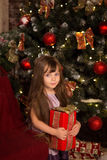 Little girle with christmass gift in her hands Stock Images
