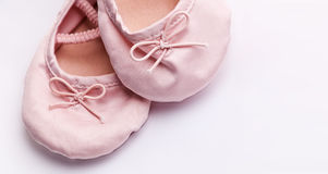 Little girlie baby shoes Stock Photos