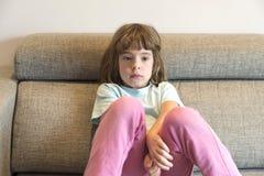 Little girll watching TV Stock Photo