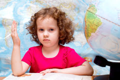 Little girllooks at the globe Royalty Free Stock Photography