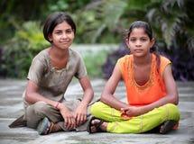 Little girls. Two little girls sitting in garden Stock Image