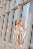 Little girls in airport near big window while wait for boarding Royalty Free Stock Photography
