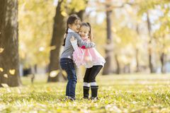 Little girls in the autumn park Royalty Free Stock Images