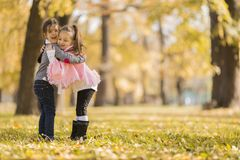 Little girls in the autumn park Royalty Free Stock Image
