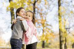 Little girls in the autumn park Stock Photo