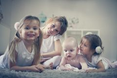 Little girls with baby brother. Portrait. royalty free stock image