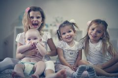 Little girls with baby brother . Portrait. stock image