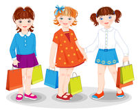 Little girls with bags. Shopping Royalty Free Stock Image