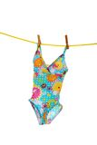 Little girls bathing suit on clothes line stock images