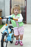 Little girl with bicycle stock image