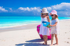 Little girls with big suitcase and map searching Stock Images