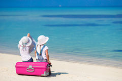 Little girls with big suitcase and map at tropical Stock Images