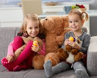 Little girls with big teddy bear smiling Royalty Free Stock Photography