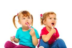 Little girls brush their teeth Stock Photo