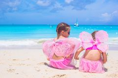 Little girls with butterfly wings on beach summer Royalty Free Stock Photography