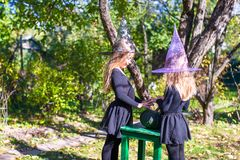 Little girls casting a spell on Halloween in witch Royalty Free Stock Images