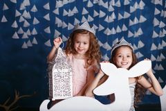 Little girls in christmas decorations. Stock Image