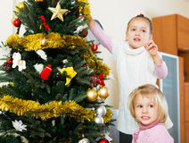 Little girls with Christmas tree Royalty Free Stock Photography