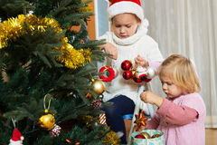 Little girls with Christmas tree Stock Photos