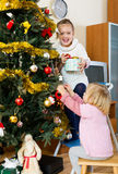 Little girls with Christmas tree Royalty Free Stock Photo