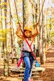 Little girls  climbing in adventure park Stock Photography