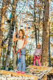 Little girls climbing in adventure park Stock Photo