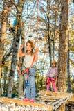 Little girls climbing in adventure park. Little girls are climbing in adventure park Stock Photo