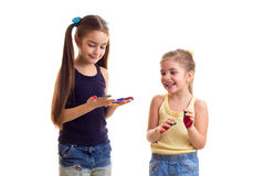 Little girls with colored hands Royalty Free Stock Photo