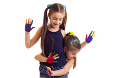 Little girls with colored hands Royalty Free Stock Photography