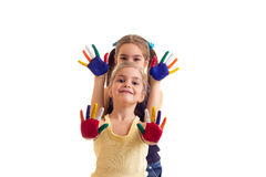 Little girls with colored hands Royalty Free Stock Image