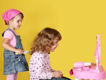Little girls are combing Royalty Free Stock Images
