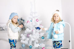 Little girls with Cristmas Tree Stock Photography
