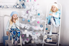 Little girls with Cristmas Tree Stock Photo