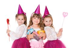 Little girls. Cute little girls with gifts and magic wands, isolated on white background Stock Photography