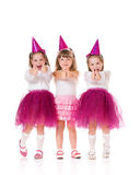 Little girls. Cute little girls showing thumbs up, isolated on white background Royalty Free Stock Images