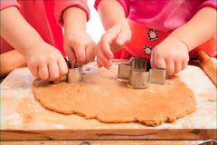 Little girls cutting christmas cookies Stock Photography