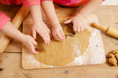Little girls cutting gingerbread christmas cookies Royalty Free Stock Photo