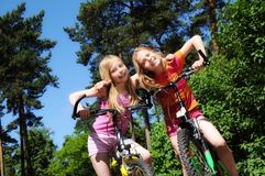 Little girls cycling Stock Photography