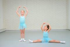 Little girls dancing ballet in studio. Young ballerinas gracefully posing at dance school, copy space royalty free stock photos