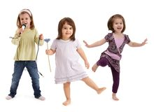 Little girls dancing having fun Stock Photos