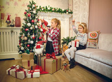 Little girls decorating Christmas tree and preparing gifts Royalty Free Stock Photography