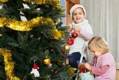 Little girls decorating Christmas tree Royalty Free Stock Photos