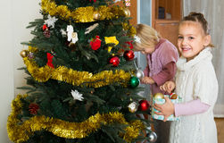 Little girls decorating Christmas tree Royalty Free Stock Images