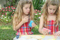 Little girls decorating cookies. Shot of little girls decorating cookies Royalty Free Stock Image